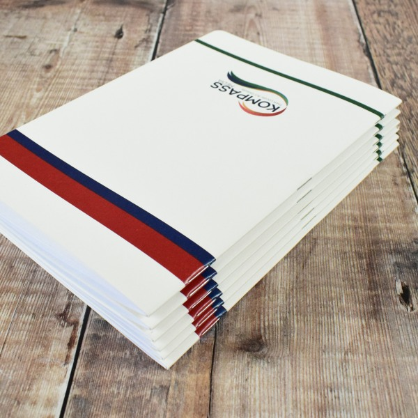 custom saddle stitched stapled notebook training workbooks - kompass media